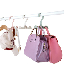 2017 New Creative Design Bag Storage Racks Rotatable Bag Hanger Wardrobe Hangers Necktie Belt Hooks Hand Bag Holder Plastic Hook(China)