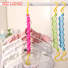 6 Hole Windproof Clothes Hanger Multifunctional Travel Magic Hanger Rack With Hook Home Wardrobe Space Save Laundry Rack(China)