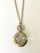 2014 Hot Free shipping wholesale 10pcs/lot vintage charm hunger games pocket watches necklace Dia28mm,original factory supply