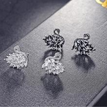 Buy LZX New Design Crystal Swan Earring White/Black Gold Color Cubic Zirconia Stone Stud Earrings Women Fashion Jewelry for $4.17 in AliExpress store