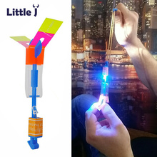 12Pcs/Lot Amazing LED Light Arrow Rocket Helicopter Rotating Flying Toys Party Fun Kids Outdoor Flashing Toy Fly Arrow