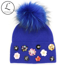 Flower Winter Hats For Women 2017 Ladies Winter Hat With Flower Cool Knitted Wool Beanie Womens Beanie Real Raccoon Fur Pompom(China)