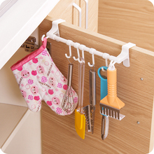 Multifunctional plastic towel bar holder over the kitchen cabinet cupboard door with 7 hook hanging rack kitchen accessories.