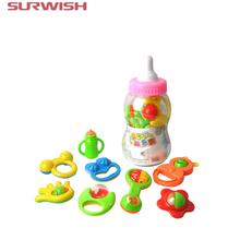 Surwish 8Pcs Kids toys Baby Hand Shake Bell Ring Rattles Toy Gift Set with Giant Baby Bottle ( shape and color send by random )