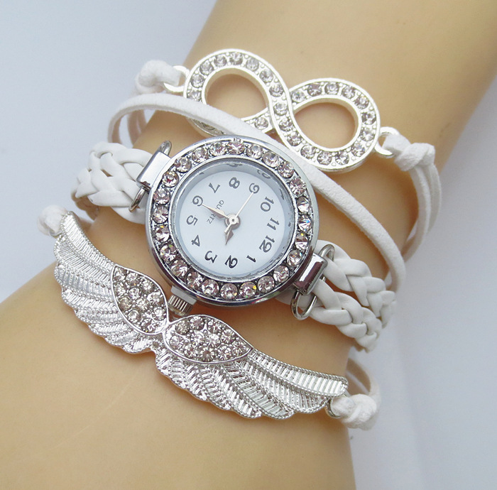2016 New Fashion 8 Letter Wing Bracelet Watch Women Rhinestone Leather Strap Quartz Dress Watches Ladies Wristwatches White Hot<br><br>Aliexpress