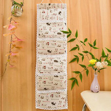 1 pc unique 68*21cm 5 Pockets Hanging Storage Bag Door Wall Mounted Home Sundries Clothing Jewelry Closet creative style(China)