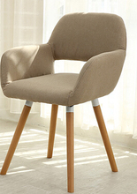 The Nordic chair solid wood chair, cloth art single person sofa chair.
