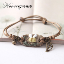 2017 New Fashion Bohemia Handmade Knitted Clay Bee Small Bell and Leaves Charm Bracelets for Women Girls Gifts(China)