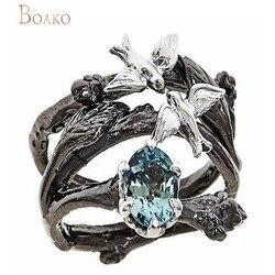 Женское кольцо с голубым фианитом
