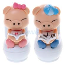 Cute Solar Powered Bobble Head Pig Sitting On Toilet Home Car Ornament Kids Toy Blue(China)