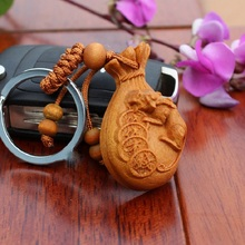On Sale 1pc/lot rosewood money bag shaped carved Keychain Cheap car key pendant Lucky wood ornaments charms Handbag pendant(China)