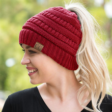 2017 Fashion CC Warm Winter Hat For Women Ponytail Beanie Stretch Cable Knit Messy Bun Hats Ski Cap Wholesale Hip-Hop Skullies(China)