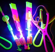 15CM Blue Light 4 Colors Can Choose LED Light Slingshot Elastic Arrow Rocket Helicopter Flying Toy Party Fun Gift