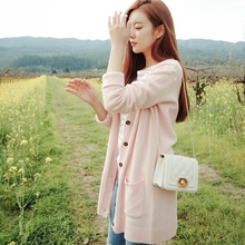 The poem Jia'en Korean women spring sweet loose coat sweater V collar sweater pocket in long cardigan(China)