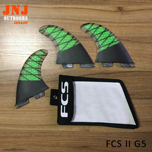 Surfboard fins FCS II Base Surfing thrusters made of carbon and fiberglass with a bag