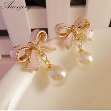Anenjery High Quality Delicate Gold Color Pink Drops Of Oil Butterfly Bow Knot Pearl Stud Earrings For Women brincos E22(China)