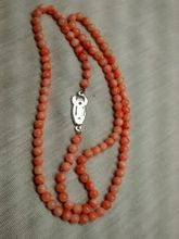 1022 round salmon angel skin coral tone clasp necklace