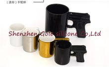 24set=48pcs Creative Gun Style Handle Ceramic Coffee Water Mug Cup 100ml Funny creative pistol shape ceramic cup ceramic cup(China)