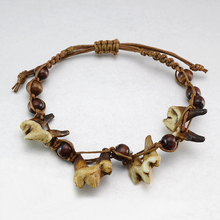 Wholesale Lot f 10PCS Handcrafted Vintage Look Tibetan Tribal Wolf Tooth Charm Braided Bracelet(China)