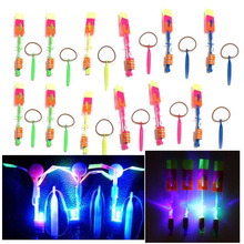Hot 12Pcs/lot Amazing LED Light Arrow Rocket Helicopter Rotating Flying Toys Party Fun Kids Outdoor Flashing Toy Fly Arrow(China)