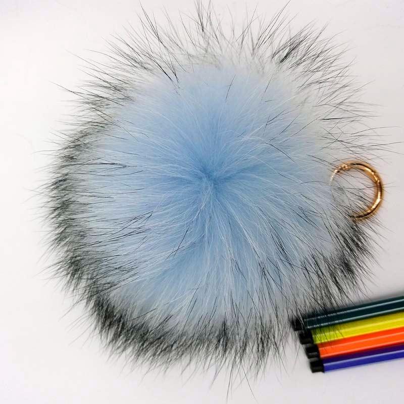 raccoon fur pompom light blue_