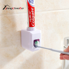 Automatic Toothpaste Dispenser Family Toothbrush Holder Bathroom Household Items Toothpaste Dispenser(China)