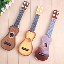 vroegschoolse educational toys Vier snaren gesimuleerde 11 inch kleine sine string gitaar musical instruments toys for children