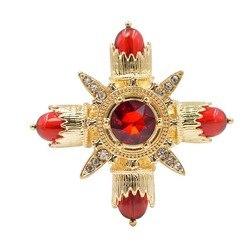 Женская брошь в виде креста красного цвета