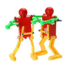 Robots Toys 2PCS/lot Clockwork Spring Wind Up Toy Dancing Robot Baby Toys for Children Kids Toy Random Color Brinquedos(China)