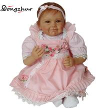 Dongzhur Npkdoll Solid Silicone Reborn Baby Doll Pink Apron Baby Photography Clothing Props Nanny Training Dolls Christmas Gift(China)