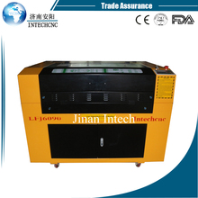 Alibaba trade assurance 6090 laser metal engraving machine/laser iron sheet cutting machine