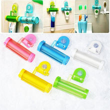 5colors Rolling Squeezer Toothpaste Dispenser Tube Partner Sucker Hanging Holde distributeur dentifrice Bathroom Accessories(China)