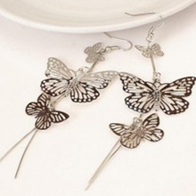 Popular personalized earrings Korean jewelry bohemian fringed long paragraph three hollow butterfly earrings