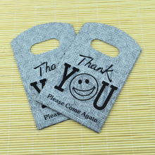 9*15CM 150pcs/lot Gray Smile Face small plastic bag jewelry gift packaging bag cute plastic gift bags shopping bags with handle(China)