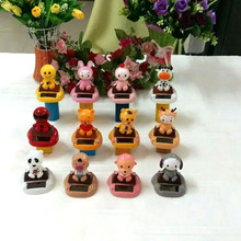 Wholesale 12 Pieces Per lot  Swing Under Full Light No Battery  Mixing Different  Animal Styles Solar  Powered Cartoon Dolls