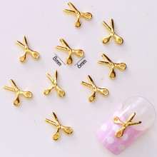10Pcs/Lot 6*8mm Gold Scissors 3D DIY Metal Alloy Nail Art Decorations Nail Stickers Jewelry Accessories(China)
