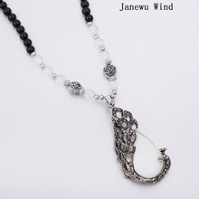 Janewu Wind rhinestone Feather opal Peacock Pendant Necklace women Black Beads long chain Mascot Necklace female