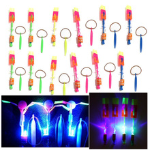 12Pcs/Lot Amazing LED Light Arrow Rocket Helicopter Rotating Flying Toy Fun Night Flashing Fly Arrow Kids Outdoor Flashing Toy