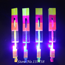 1PcShining Rocket  Arrow  Neon Led Light Amazing Elastic Powered LED Arrow Helicopter Flying Toy Gifts