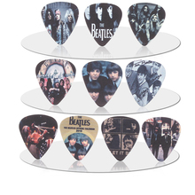 SOACH 10pcs 0.71mm Guns N 'Roses band quality two side earrings Accessories pick DIY design guitar pick(China)