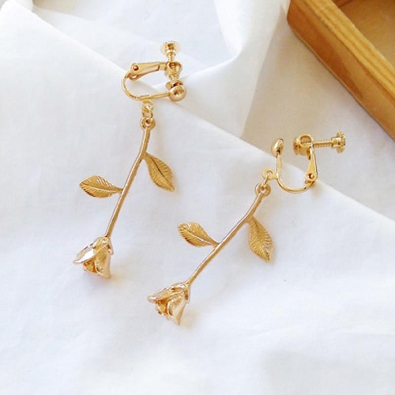 gold rose clip earrings