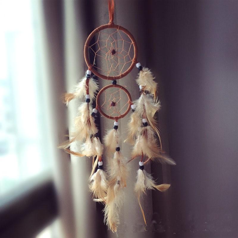 Attrape rêves Artisanal décoratifs plumes décoration intérieur capteur de rêves indien culture amérindiennes idées déco Dreamcatcher Marron