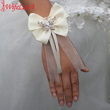 Wifelai-a New Design 2pcs/lot Ivory Silk Bow Tie Butterfly Crystal Wrist Flowers Bride Ribbon Wedding Corsage Hand Flowers(China)