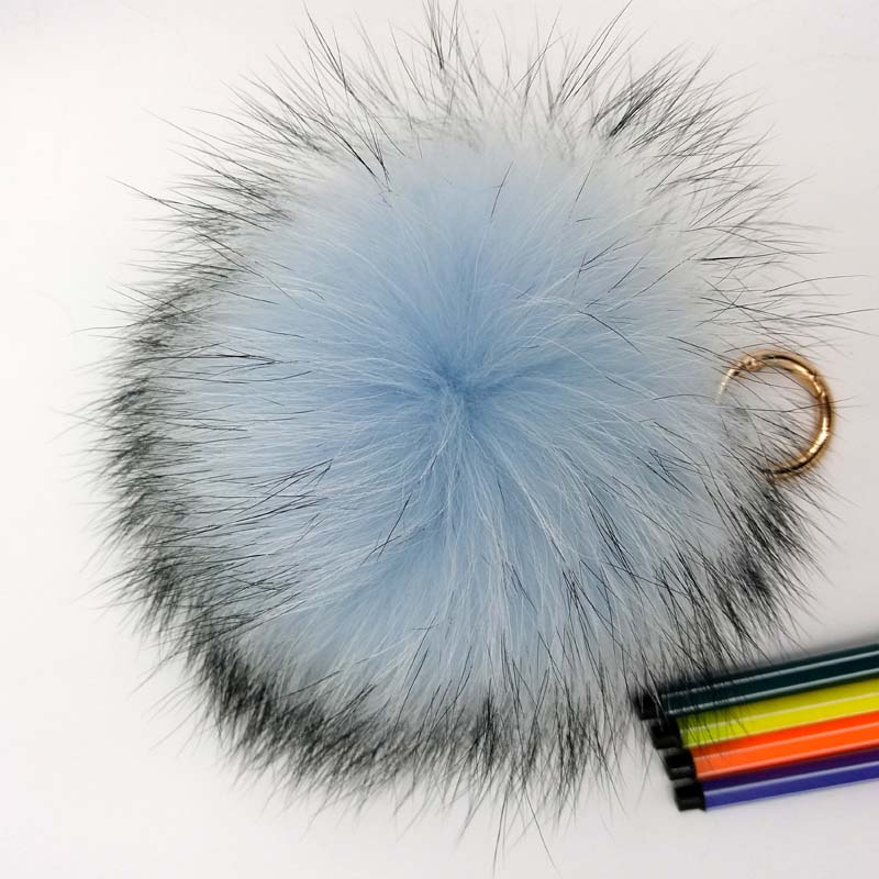 raccoon fur pompom light blue