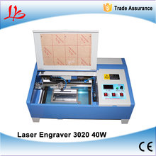 FREE SHIPPING!! LY 3020 Digital CO2 Laser Engraving Machine, laser milling/cutting machine with honeycomb(China)