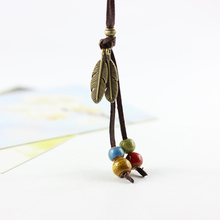 Simple National Style 100% Handmade Creative Ceramic Leather Cord Necklace Pendant Feather Adorn Article for Women