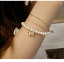 SL063 2017 Latest Fashion Multilayer Sweet Lady Imitation Pearl Bow Three Bracelets Jewelry Factory Direct