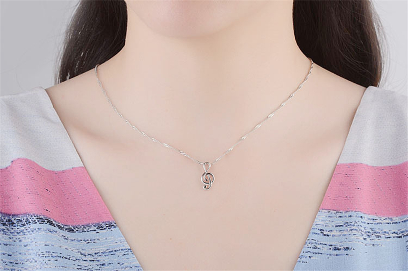 silver music necklace