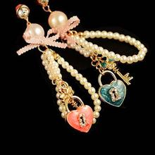 Fashion Heart Shaped Key Pearl Chain Earphone Dust Plug Headphone Jack Dustproof For iPhone Samsung Huawei 3.5mm(China)