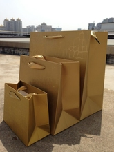 Wholesale 100PCS/LOT Gold With Film Paper Gift Bag 7 Size Included Free Design Print LOGO(China)